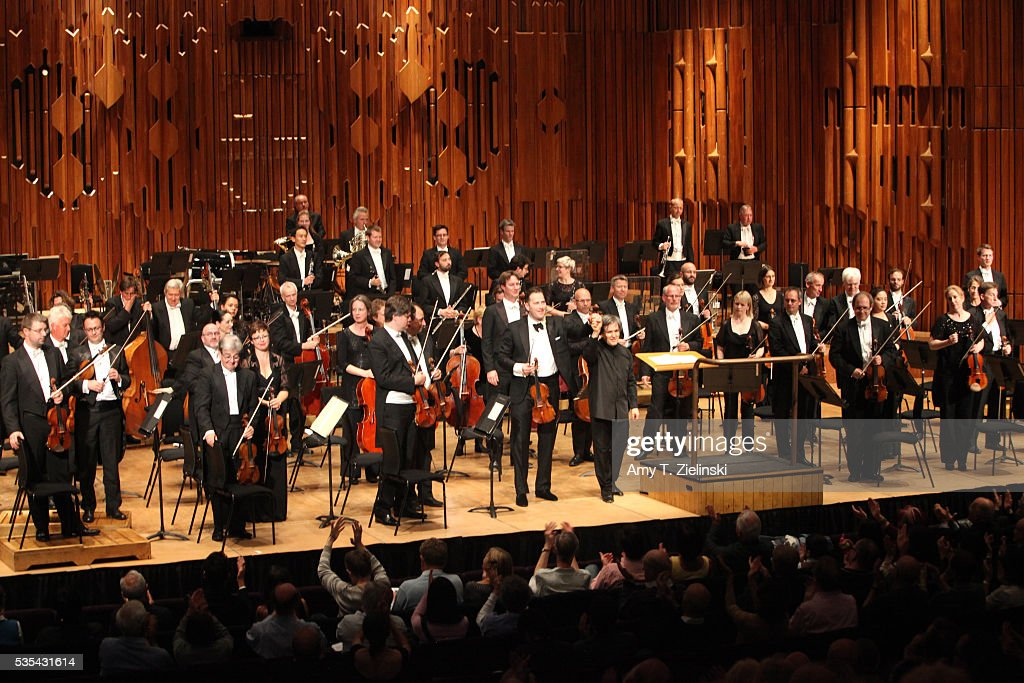 The concertmaster and sir Antonio Pappano before receive the audience after conducting the London Symphony Orchestra in the Beethoven Violin Concerto with soloist violinist Nikolaj Znaider at Barbican Centre on May 29, 2016 in London, England.