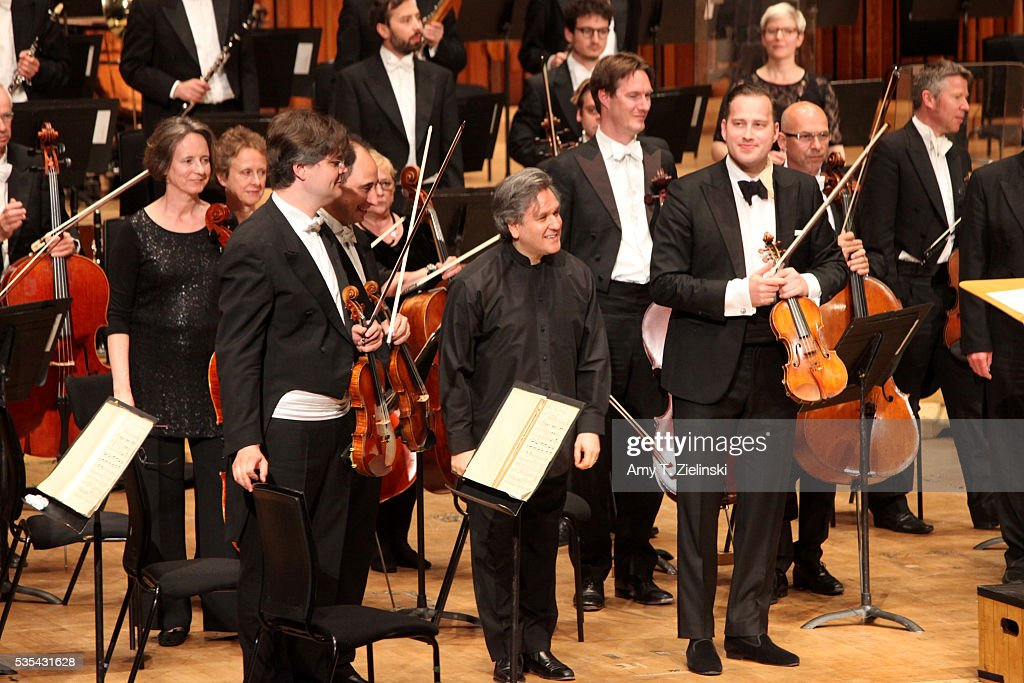The concertmaster and sir Antonio Pappano before receive the audience before he conducts the London Symphony Orchestra in the Beethoven Violin Concerto with soloist violinist Nikolaj Znaider at Barbican Centre on May 29, 2016 in London, England.