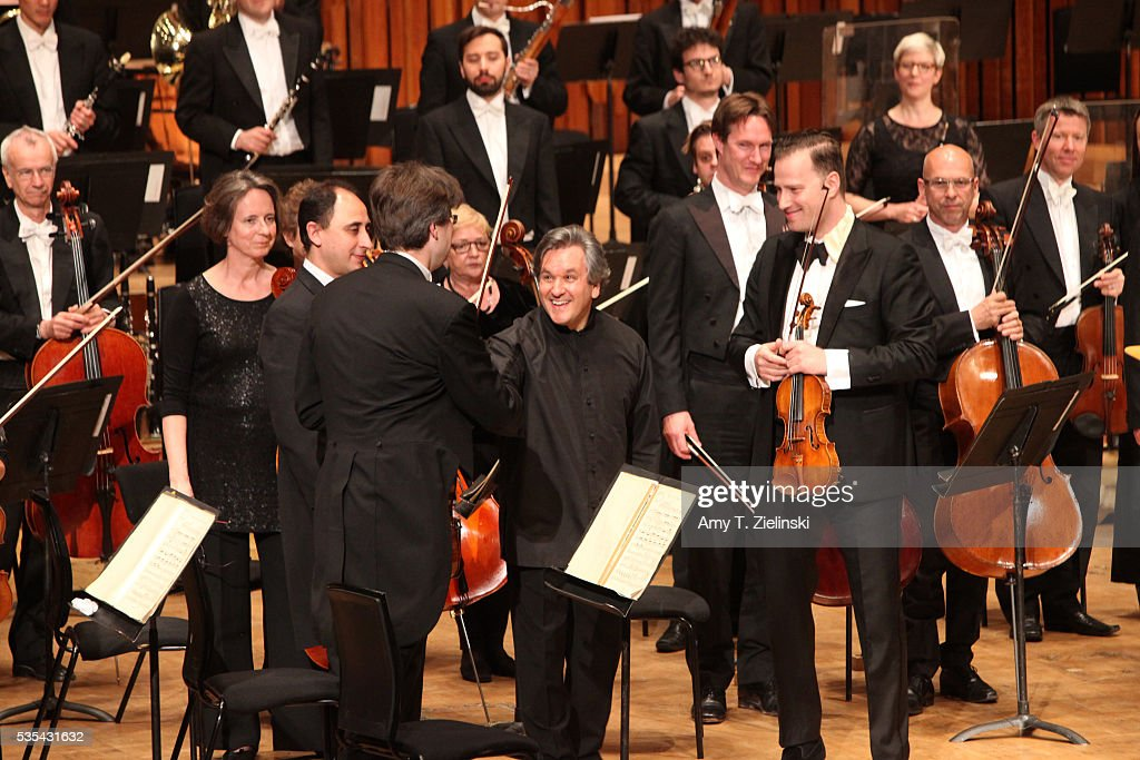 The concertmaster greets Sir Antonio Pappano before he conducts the London Symphony Orchestra in the Beethoven Violin Concerto with soloist violinist Nikolaj Znaider at Barbican Centre on May 29, 2016 in London, England.