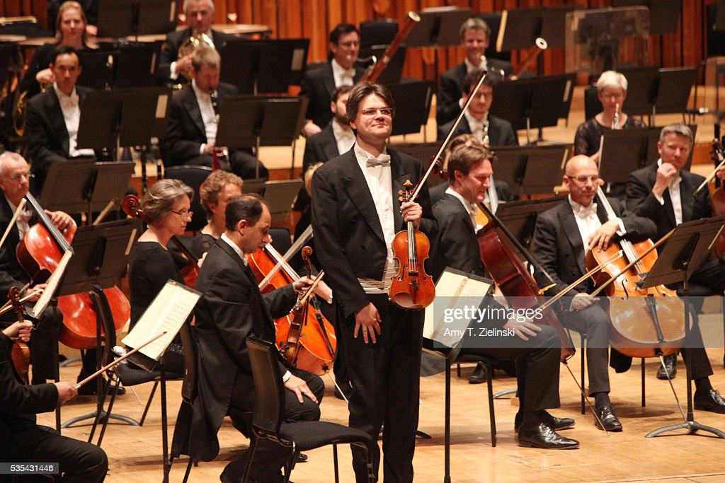 The concertmaster receives the audience before Sir Antonio Pappano conducts the London Symphony Orchestra in the Beethoven Violin Concerto with soloist violinist Nikolaj Znaider and after interval the Elgar Symphony No 2 at Barbican Centre on May 29, 2016 in London, England.