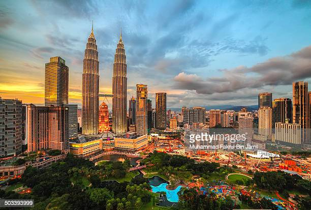 CONTENT] The Concrete Jungle of Kuala Lumpur City Centre point of view of Petronas Twin Towers during sunset or dusk