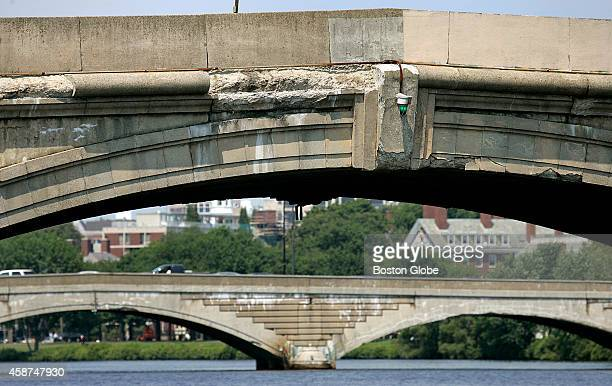 The concrete missing off the bridge by River Street in Cambridge Mass is pictured The Western Avenue bridge is in the background