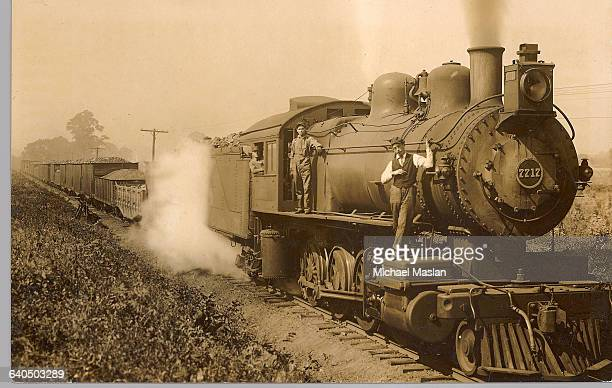 The conductor and engineers pose on a steam locomotive in New Philadelphia Ohio ca 1930s | Location New Philadelphia Ohio USA