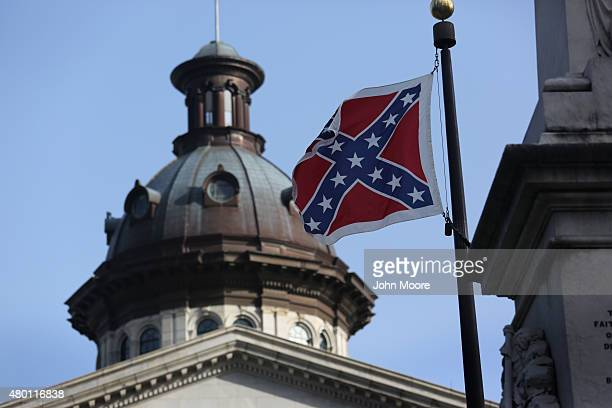 The Confederate flag flies in front of the South Carolina statehouse for the last full day on July 9 2015 in Columbia South Carolina South Carolina...