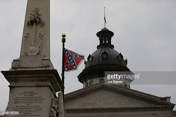 The Confederate flag flies on the Capitol grounds after South Carolina Gov Nikki Haley announced that she will call for the Confederate flag to be...