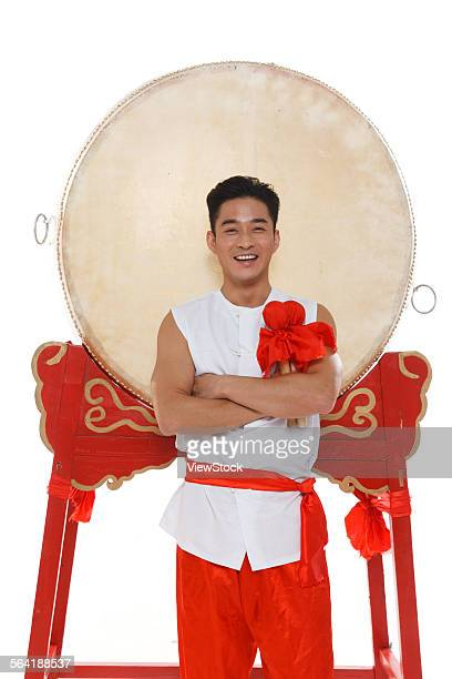 The confident young man standing at the side of the drum