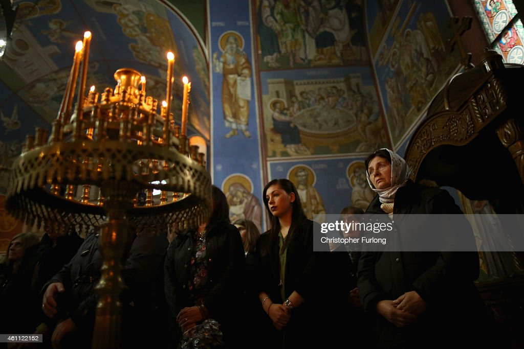 The congregation of Serbian Orthodox Christians celebrate the Nativity of Christ liturgy at Lazarica church in Bournville on January 7 2015 in...