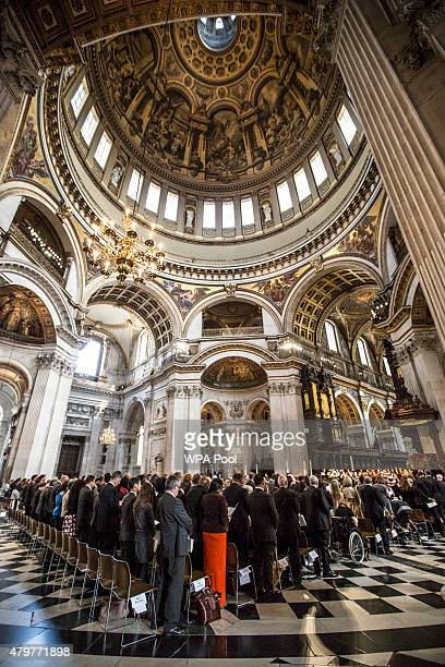The congregation stands for the minutes silence to during the service to commemorate the tenth anniversary of the London 7/7 bombings at St Pauls...