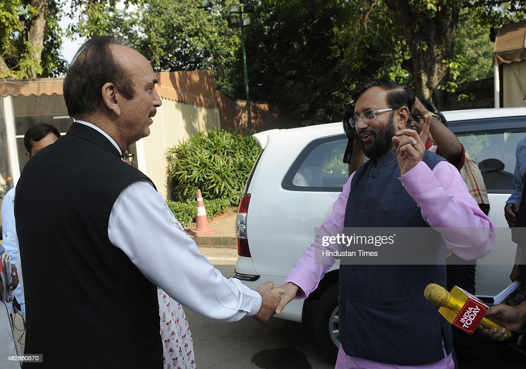 The congress leader <a gi-track='captionPersonalityLinkClicked' href=/galleries/search?phrase=Ghulam+Nabi+Azad&family=editorial&specificpeople=772783 ng-click='$event.stopPropagation()'>Ghulam Nabi Azad</a> and BJP leader Prakash Javdekar during the monsoon session at the Parliament House on August 3, 2015 in New Delhi, India. 25 of Congress party's 44 members in Lok Sabha were today suspended for five days for causing disruptions, setting the stage for escalation in confrontation as nine opposition parties decided to boycott the House for these days to express solidarity with the suspended members.