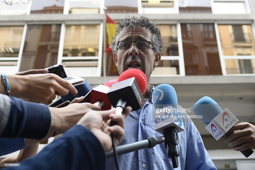 The congressional spokesperson for Amaiur, left-wing Basque nationalist and separatist political coalition, Xabier Mikel Errekondo speaks to the press in front of Madrid's High Court on October 3, 2013 in support of detained Basque separatist association Herrira leaders facing judges today. Police detained Herrira leaders on September 30 in simultaneous raids carried out in Bilbao, Hernani, Pamplona and Vitoria and closed down 38 websites run by the group as well as dozens of Facebook and Twitter accounts, and froze its bank accounts. The arrests come as ETA is under pressure to give up its arms.