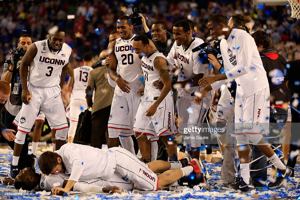 The Connecticut Huskies celebrate after defeating the Kentucky Wildcats 60-54 in the NCAA Men's Final Four Championship at AT&T Stadium on April 7, 2014 in Arlington, Texas.