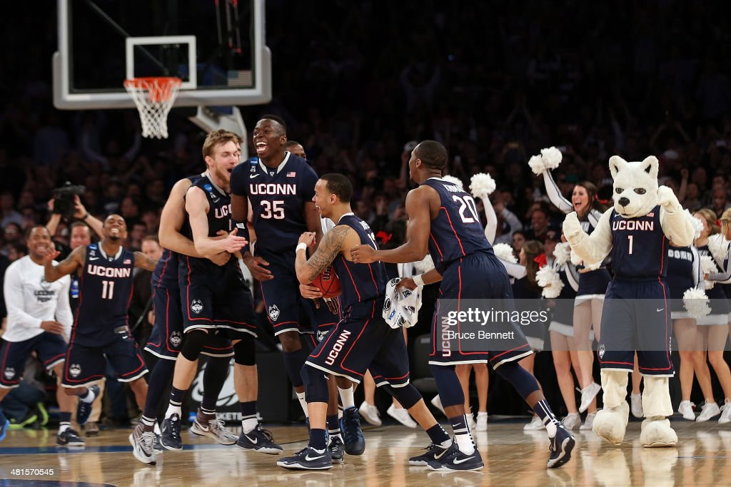 The Connecticut Huskies celebrate after defeating the Michigan State Spartans during the East Regional Final of the 2014 NCAA Men's Basketball...