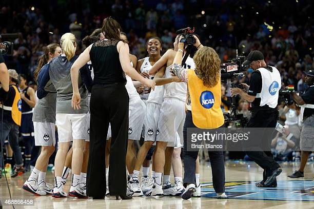 The Connecticut Huskies celebrate after defeating the Notre Dame Fighting Irish 6353 during the NCAA Women's Final Four National Championship at...