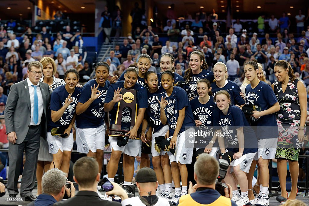 The Connecticut Huskies celebrate on stage after defeating the Notre Dame Fighting Irish 6353 during the NCAA Women's Final Four National...