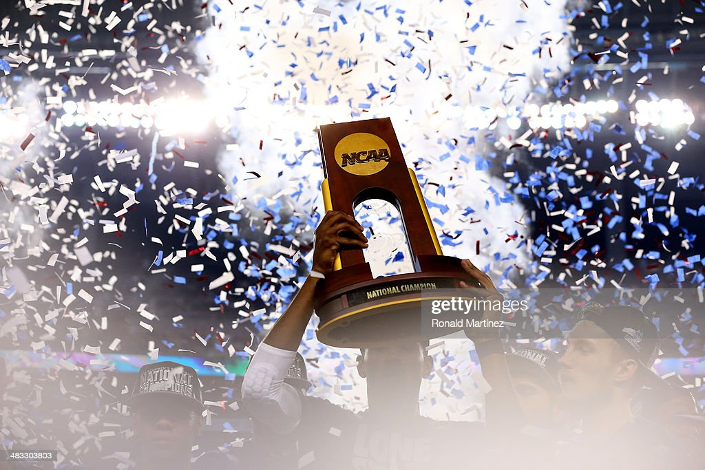 The Connecticut Huskies celebrate with the trophy after defeating the Kentucky Wildcats 6054 in the NCAA Men's Final Four Championship at ATT Stadium...
