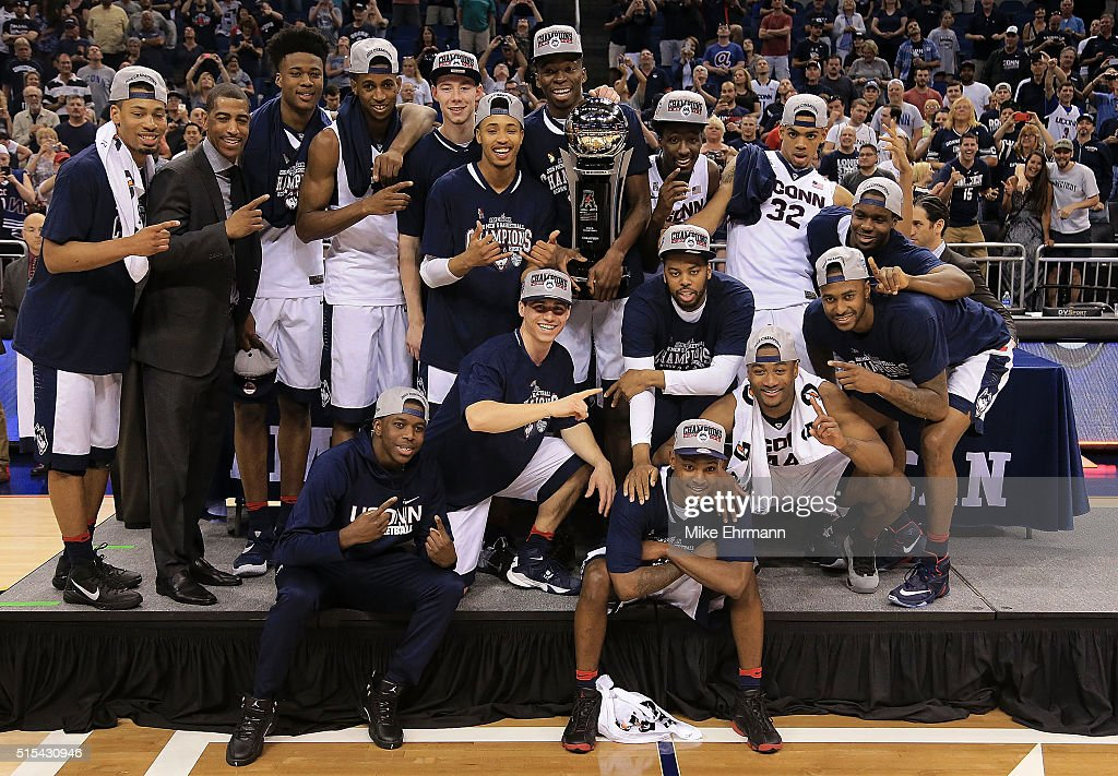 The Connecticut Huskies celebrates after winning the Final of the 2016 AAC Basketball Tournament against the Memphis Tigers at Amway Center on March...
