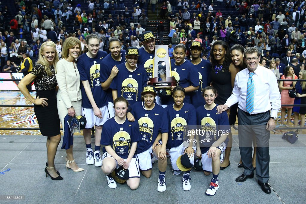 The Connecticut Huskies pose after defeating the Notre Dame Fighting Irish 79 to 58 in the NCAA Women's Final Four Championship at Bridgestone Arena on April 8, 2014 in Nashville, Tennessee.