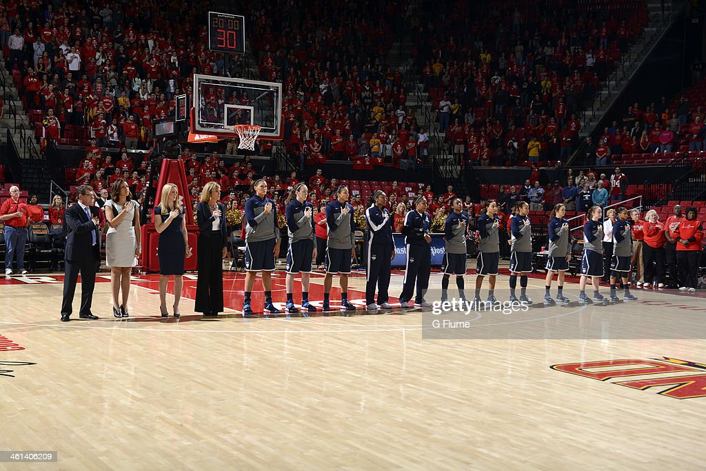 The Connecticut Huskies stand for the national anthem before the game against the Maryland Terrapins at the Comcast Center on November 15, 2013 in College Park, Maryland.