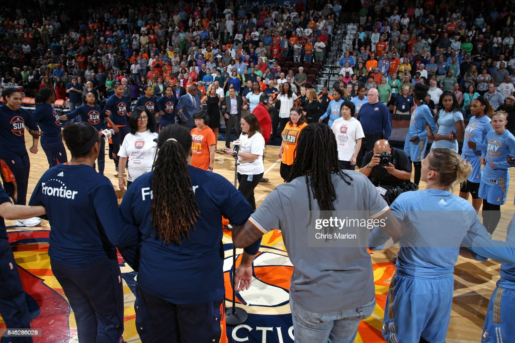 The Connecticut Sun and the Chicago Sky stand for a moment of silence for the National Anthem before the game during a WNBA game on August 25, 2017 at the Mohegan Sun Arena in Uncasville, Connecticut.