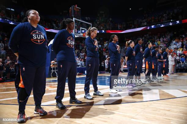 The Connecticut Sun stand for the National Anthem before the game against the Dallas Wings on August 12 2017 at Mohegan Sun Arena in Uncasville CT...