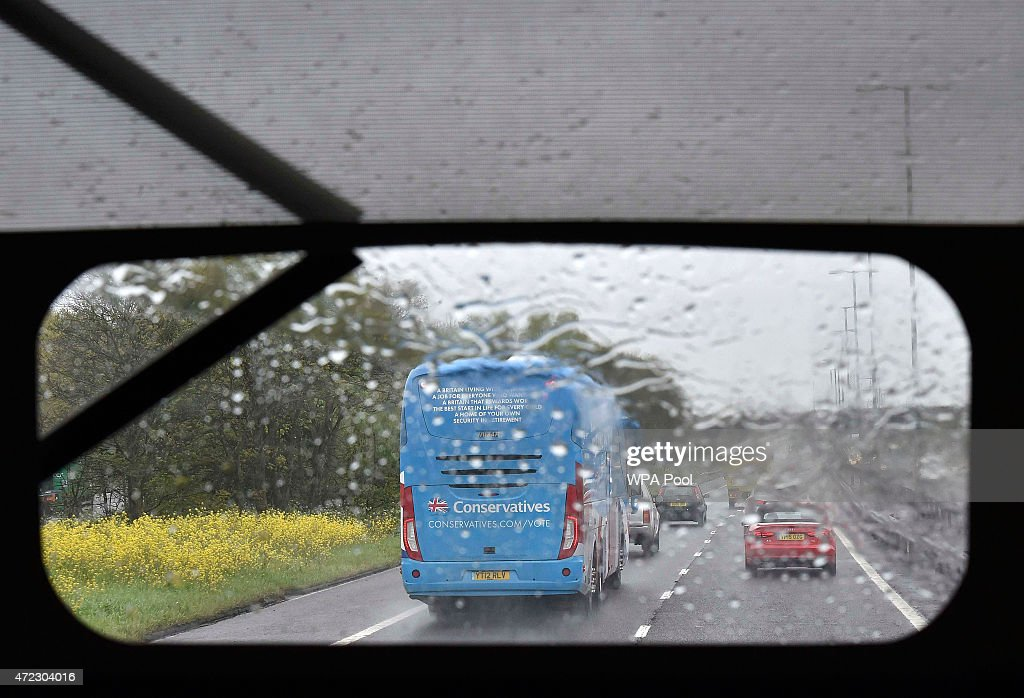 The Conservative Party campaign bus is seen travelling through heavy rain on the M6 motorway, on May 6, 2015 in England. Britain's political leaders are campaigning in a final day's push for votes ahead of what is predicted to be the closest General Election for a generation.