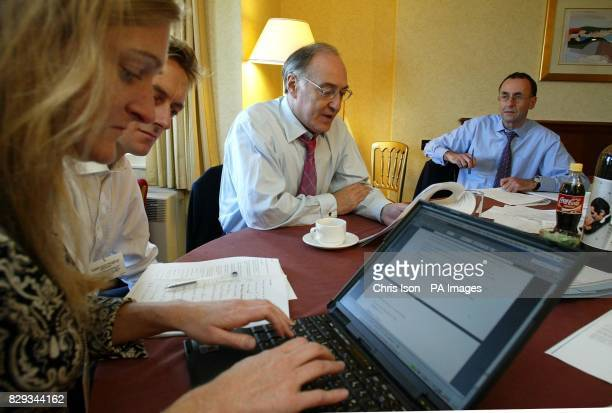 The Conservative Party Leader Michael Howard prepares his speech in his hotel room with his Political Secretary Rachel Whetstone George Bridges...