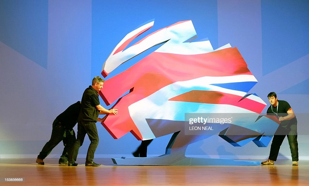The Conservative Party logo is repositioned ahead of a keynote address from British Prime Minister David Cameron on the final day of the 2012...
