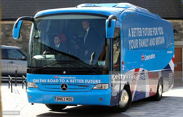 The Conservative Party's election bus arrives with David Cameron UK prime minister and leader of the Conservative Party on board before he unveils...