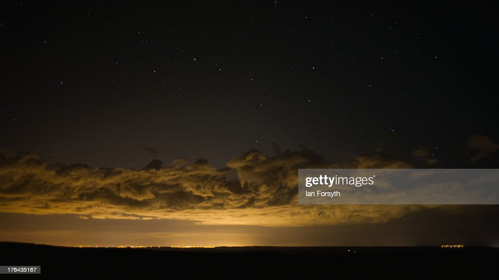The constellation of Ursa Major can be seen in the night sky above clouds that are lit from below by industrial factories on Teesside on August 13, 2013 on the North Yorkshire Moors, United Kingdom.