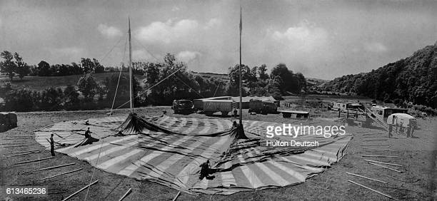 The construction of the big top in a Devonshire field The men who in a few hours will be the heroes of the crowd the liontamers the clowns the bare...