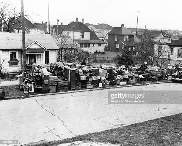 The contents of a threeroom house in Los Angeles are piled up in the street after the owners were evicted circa 1935