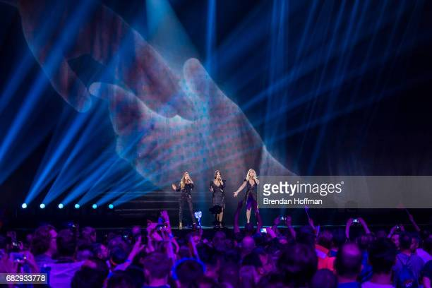 OG3NE the contestants from the Netherlands a group composed of three sisters Lisa and twins Amy and Shelley perform during the second Eurovision...