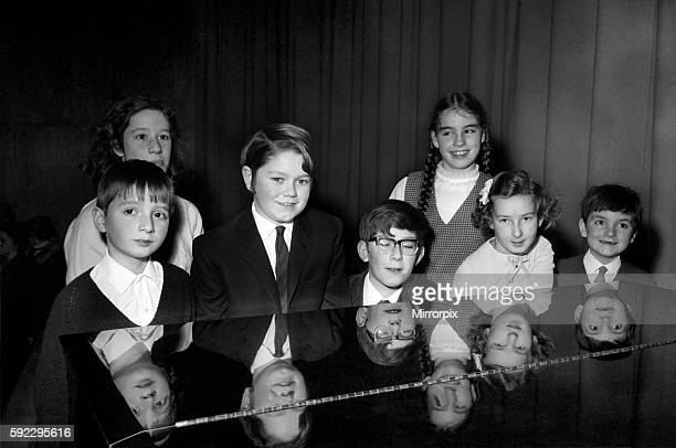 The contestants in the Junior section are reflected in the top of the grand piano they played during the contest winner Francis Rayner from Glamorgan...