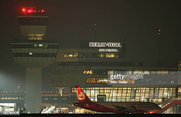 The control tower and main terminal at Tegel Airport stand illuminated on February 25 2013 in Berlin Germany Due to delays in construction of the new...