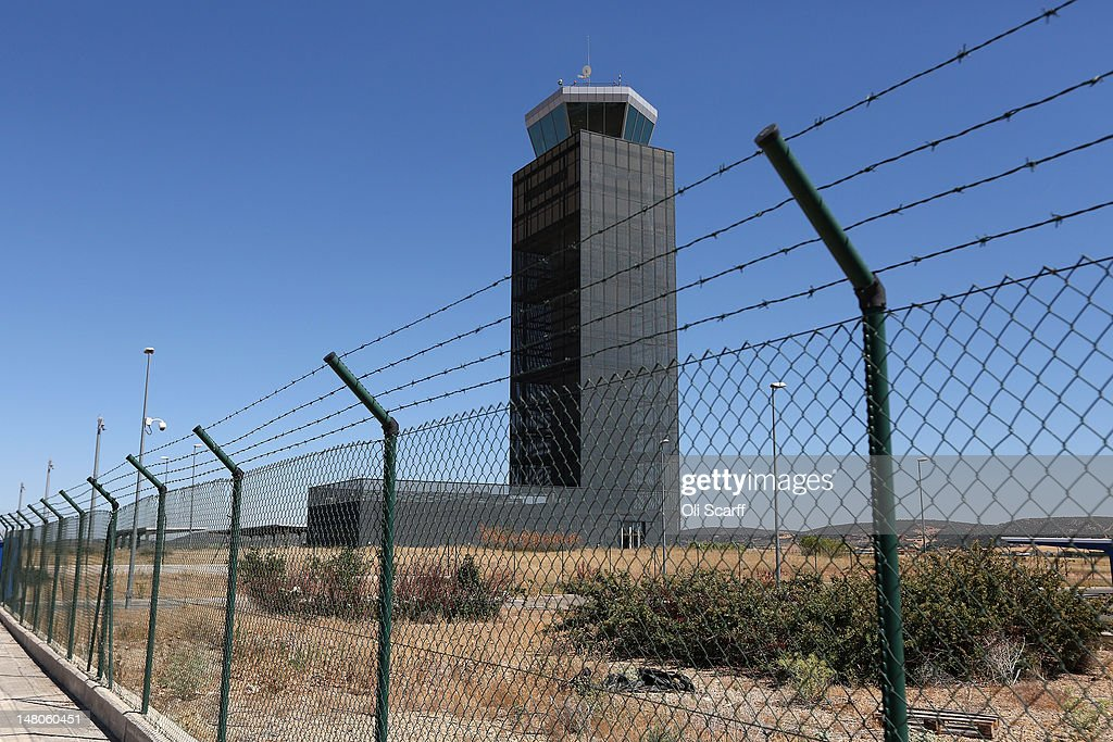 The control tower of Cuidad Real International Airport stands dormant after closing in April 2012, when all scheduled flights ceased to operate to or from it, on July 6, 2012 in Ciudad Real, Spain. The large international airport, which was completed in 2009 at a cost of 1.1 billion euros, was intended to serve both Madrid and the Andalucían coast, accessible in 50 minutes via a high speed rail link, however lack of demand driven by Spain's economic crisis has seen closure after just three years. Despite having the fourth largest economy in the Eurozone, the economic situation in Spain remains troubled with their unemployment rate the highest of any Eurozone country. Spain is currently administering billions of euros of spending cuts and tax increases in a bid to manage its national debt. Spain also has access to loans of up to 100 billion euros from the European Financial Stability Facility which will be used to rescue the country's banks that have been badly affected by a crash in property prices.