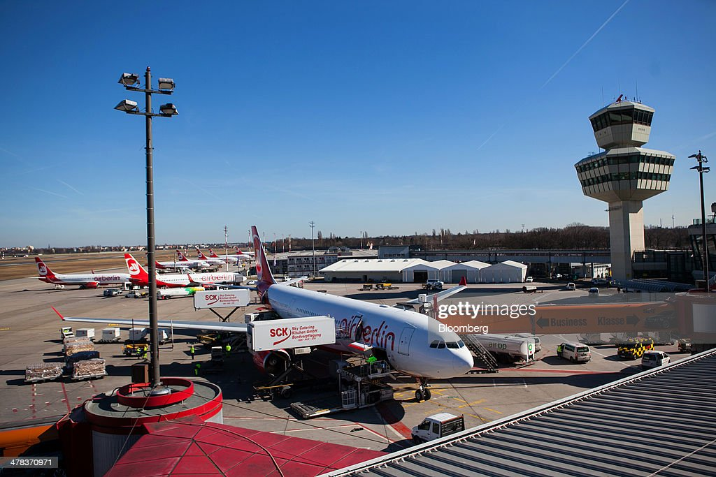 The control tower stands as Air Berlin aircraft sit on the tarmc at Tegel airport, operated by Flughafen Berlin Brandenburg GmbH, in Berlin, Germany, on Wednesday, March 12, 2014. Berlin's Tegel airport has subsisted by chance alone, defying the odds as passenger growth outpaces every other major hub in Western Europe. Photographer: Krisztian Bocsi/Bloomberg via Getty Images