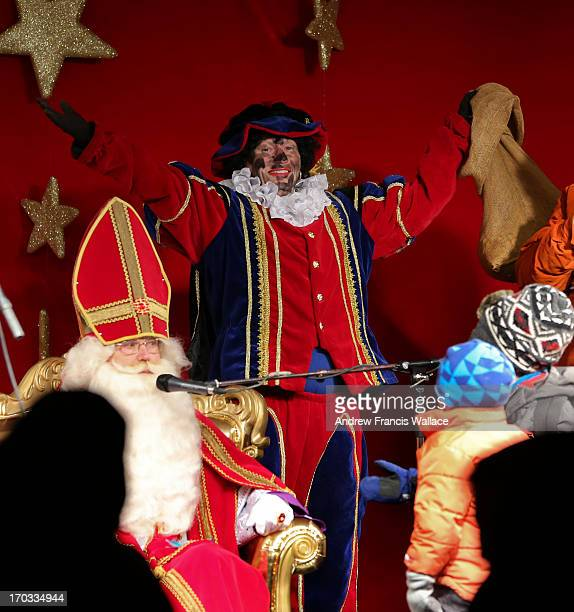 The controversial 'Black Pete' on stage with Sinterklaas in the Distilary District December 5 2012 The tradition character in Dutch Christmas has...