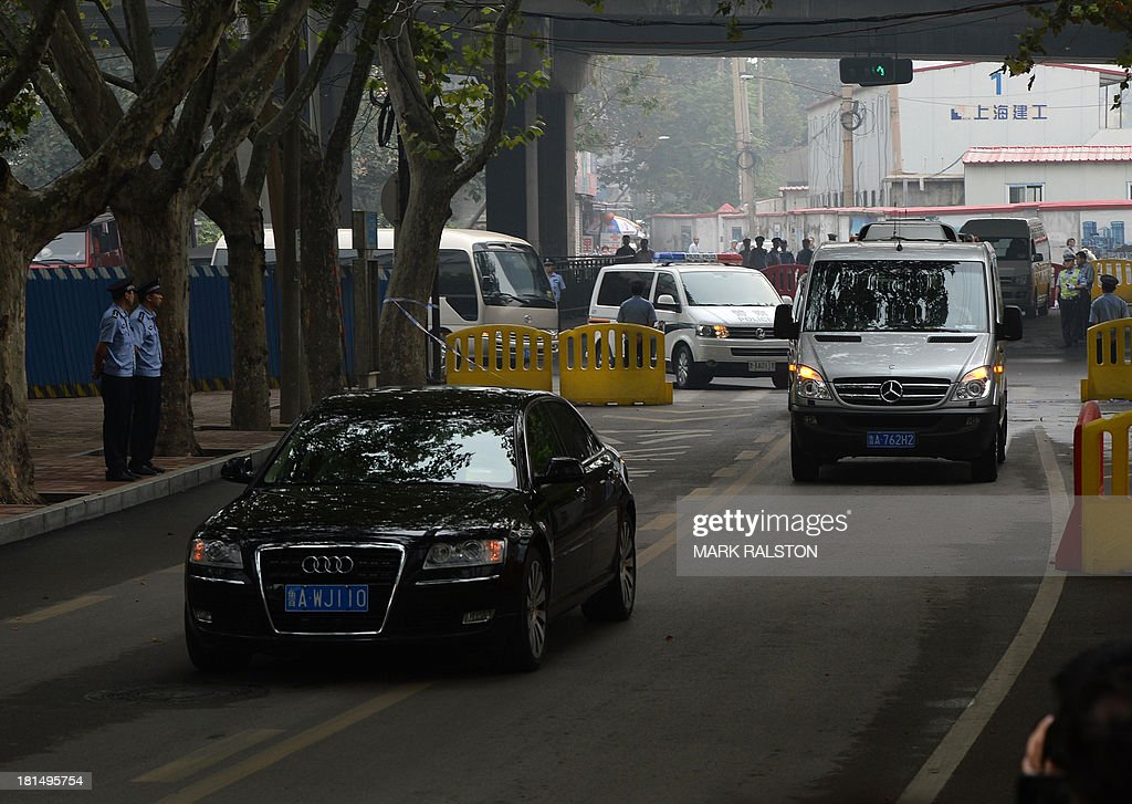 The convoy believed to be carrying disgraced politician Bo Xilai arrives at the Intermediate People's Court for his sentencing in Jinan, Shandong Province on September 22, 2013. The verdict in the case of China's fallen political star Bo Xilai, will cap an extraordinary scandal involving bribes, murder, illicit love, political infighting, and a colourful yet tightly controlled trial. AFP PHOTO/Mark RALSTON