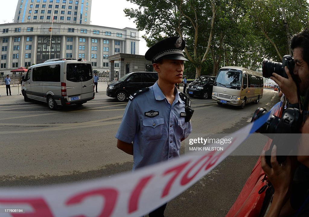The convoy carrying disgraced politician Bo Xilai and Wang Lijun arrives for the fourth day of Bo's trial at the Intermediate People's Court in Jinan, Shandong Province on August 25, 2013. Once one of China's highest-flying politicians, Bo Xilai found himself in the criminal dock on trial for bribery and abuse of power in the country's highest-profile prosecution in decades. His downfall began when a British businessman was found dead in a hilltop hotel room. As the drama finally nears its conclusion, the Communist Party is touting it as proof of its intent to crack down on corruption. AFP PHOTO/Mark RALSTON