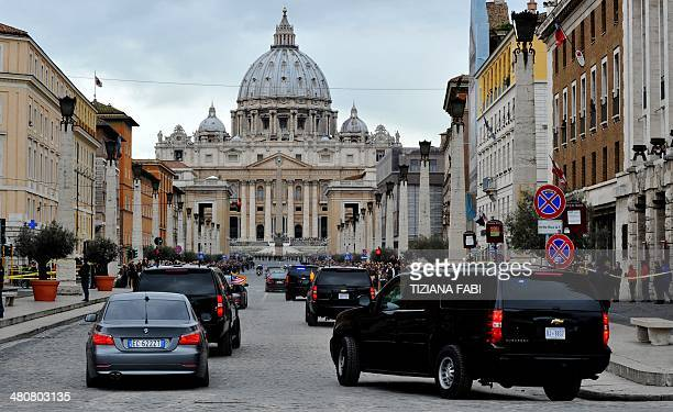The convoy of US President Barack Obama arrives on March 27 2014 in front of St Peter's basilica before a private audience with Pope Francis at the...