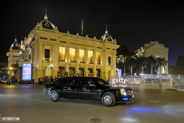 The convoy transporting US President Donald Trump passes by in front of Hanoi Opera House on November 11 2017 in Hanoi Vietnam US President Donald...