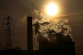 The cooling towers of Fiddlers Ferry power station emit steam on April 11 Cheshire England The world's population is more environmentally aware now...