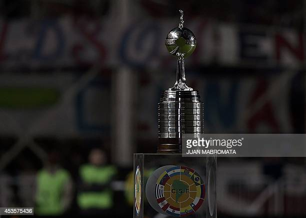 The Copa Libertadores 2014 trophy is seen before the start of the second leg football final between Argentina's San Lorenzo and Paraguay's Nacional...