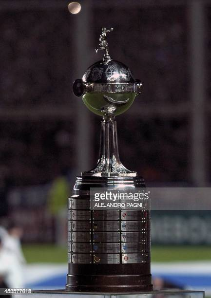 The Copa Libertadores 2014 trophy is seen before the start of the second leg final football match between Argentina's San Lorenzo and Paraguay's...