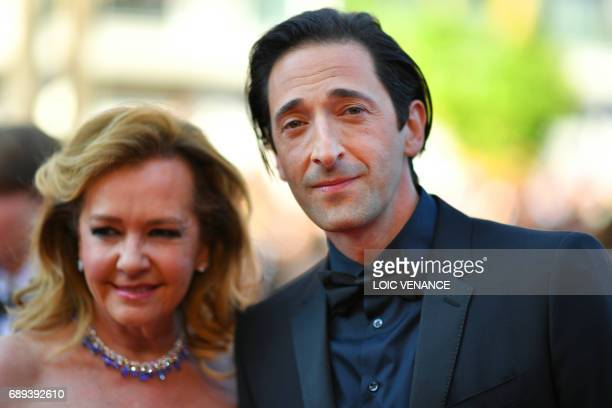 The coPresident of Chopard Caroline Scheufele and US actor Adrien Brody pose as they arrive on May 28 2017 for the closing ceremony of the 70th...