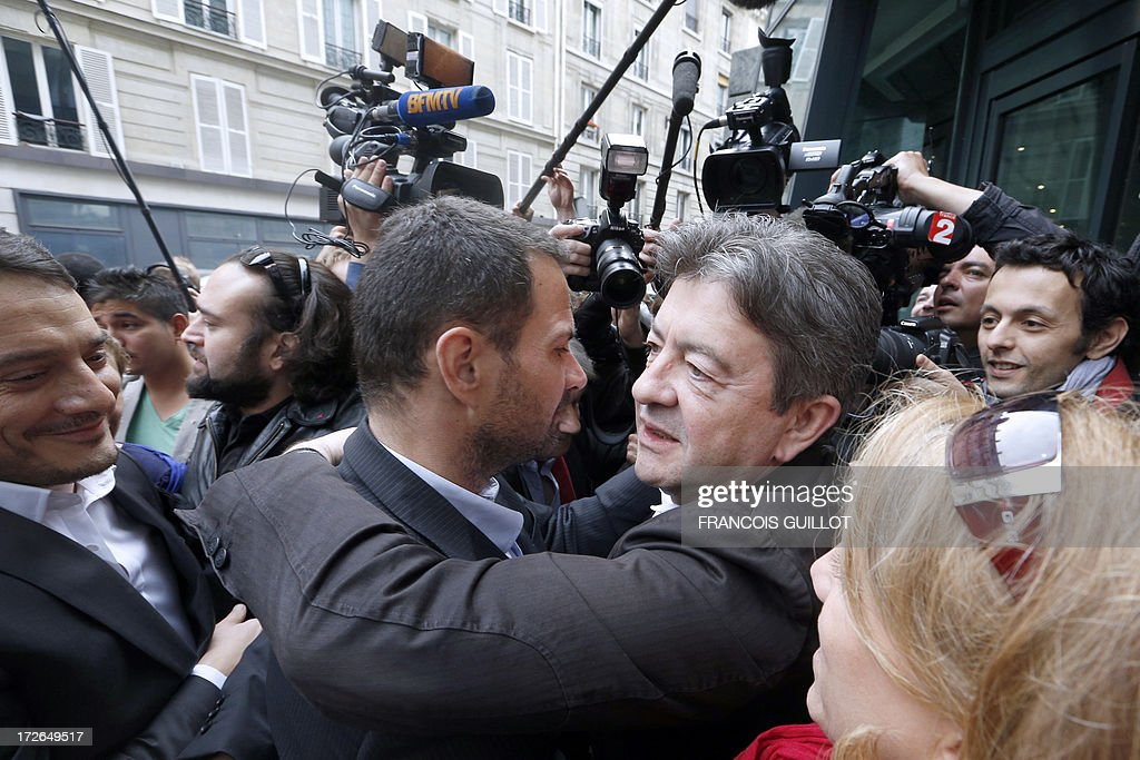 The co-President of French far-left Parti de Gauche (PG) party's Jean Luc Melenchon (R) hugs French rogue trader Jerome Kerviel upon his arrival on July 4, 2013 in Paris, at the Prudhommes court (judicial system of relations between workers and employees). Kerviel lost last year his appeal against a three-year jail term and a 4.9-billion-euro fine for his part in France's biggest rogue-trading scandal. The 35-year-old was convicted of forgery and breach of trust for gambling away nearly five billion euros ($6.3-billion) in risky deals as a star trader at Societe Generale, one of Europe's biggest banks.