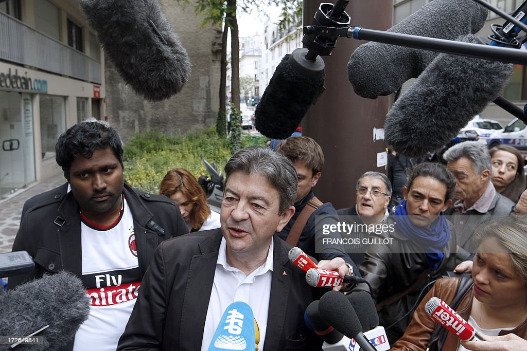 The co-President of French far-left Parti de Gauche (PG) party's Jean Luc Melenchon (C) answers to journalists as he arrives on July 4, 2013 in Paris, at the Prudhommes court (judicial system of relations between workers and employees) to support French rogue trader Jerome Kerviel. Kerviel lost last year his appeal against a three-year jail term and a 4.9-billion-euro fine for his part in France's biggest rogue-trading scandal. The 35-year-old was convicted of forgery and breach of trust for gambling away nearly five billion euros ($6.3-billion) in risky deals as a star trader at Societe Generale, one of Europe's biggest banks.