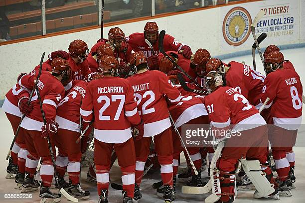 The Cornell Big Red huddle before the first period against the Princeton Tigers at Hobey Baker Rink on January 13 2017 in Princeton New Jersey...