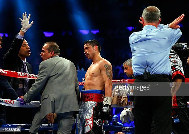 The corner for Sergio Martinez of Argentina waves to end the fight six seconds into the tenth round against Miguel Cotto of Puerto Rico during the...