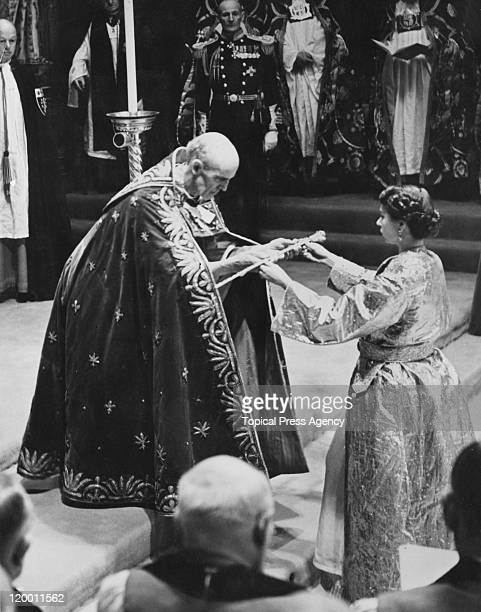 The coronation of Queen Elizabeth II in Westminster Abbey London 2nd June 1953 The Archbishop of Canterbury Geoffrey Fisher presents the Queen with...